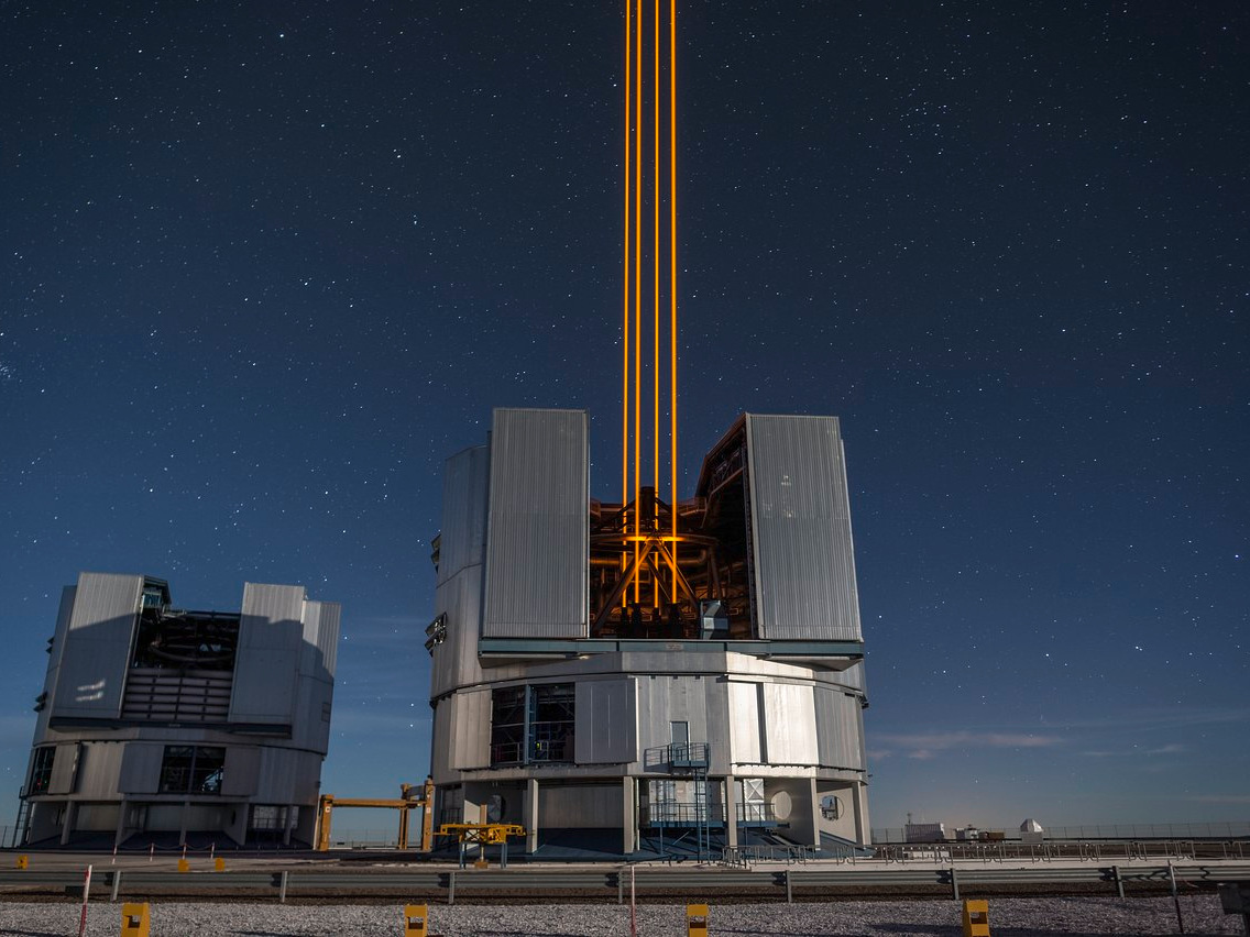 This spectacular image of four powerful beams emerging from the new laser system on Unit Telescope 4 that form a crucial part of the adaptive optics systems on ESO's Very Large Telescope. These are the most powerful laser guide stars ever used for astronomy and mark the first use of multiple laser guide stars at ESO. Image credit: ESO/F. Kamphues.