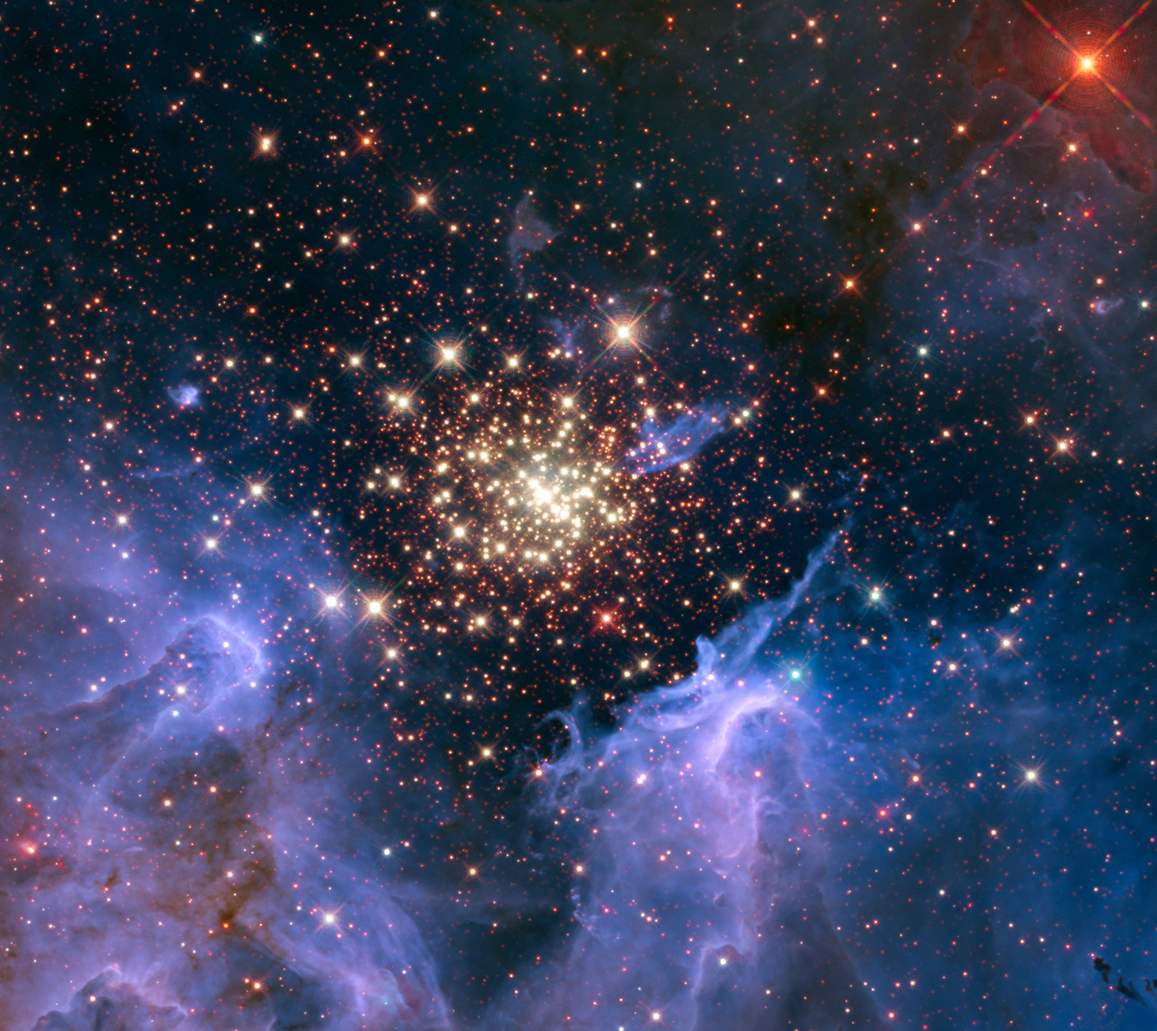 A cluster of massive stars seen with the Hubble Space Telescope. The cluster is surrounded by clouds of interstellar gas and dust called a nebula. The nebula, located 20,000 light-years away in the constellation Carina, contains the central cluster of huge, hot stars, called NGC 3603. Recent research shows that galactic cosmic rays flowing into our solar system originate in clusters like these. Image credits: NASA/U. Virginia/INAF, Bologna, Italy/USRA/Ames/STScI/AURA.