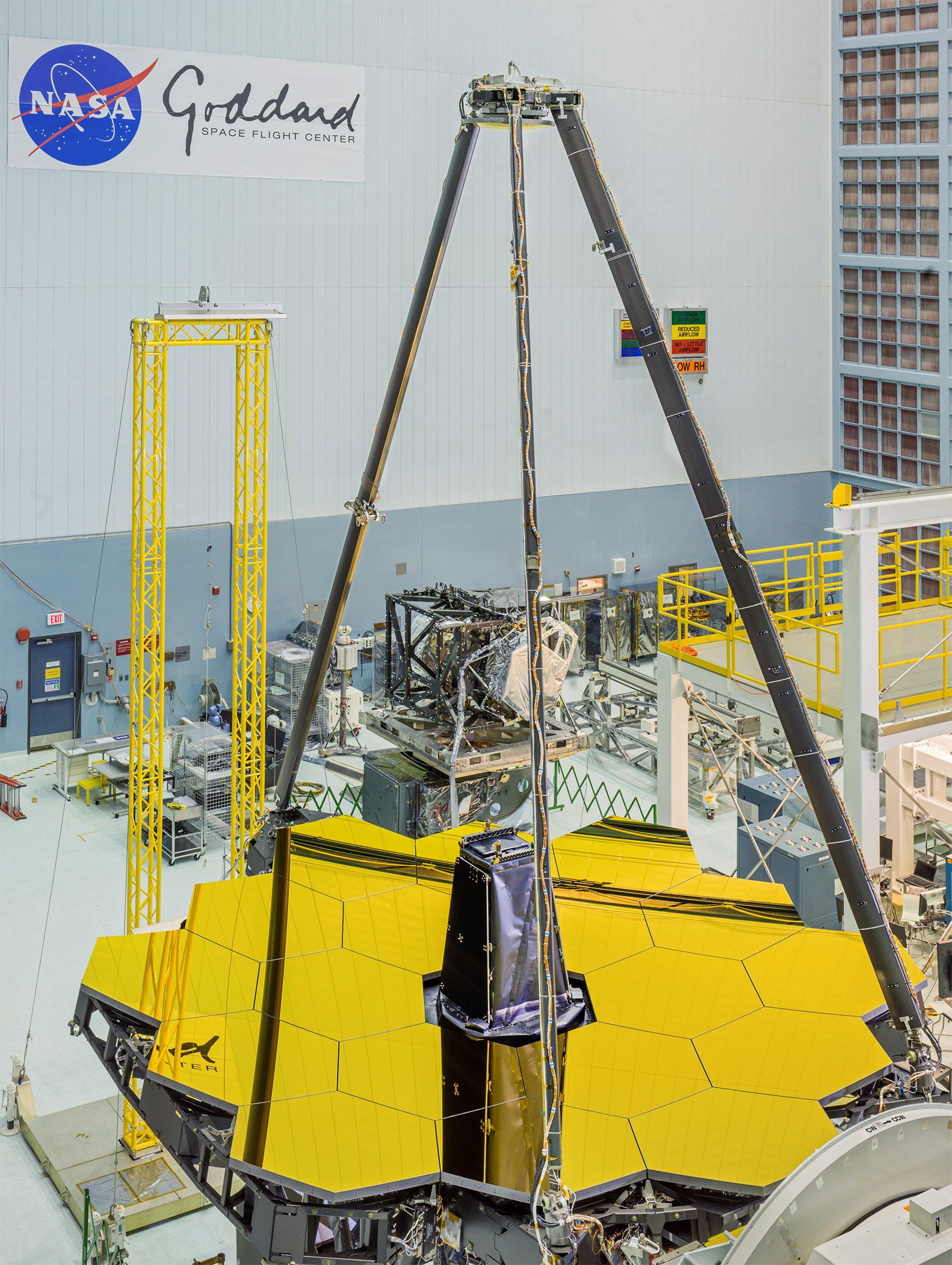 On 27 April 2016, engineers unveiled the giant golden mirror of NASA's James Webb Space Telescope as part of the integration and testing of the infrared telescope at NASA's Goddard Space Flight Center, Greenbelt, Maryland. Click the image for a full-size version. Image credits: NASA/Chris Gunn.