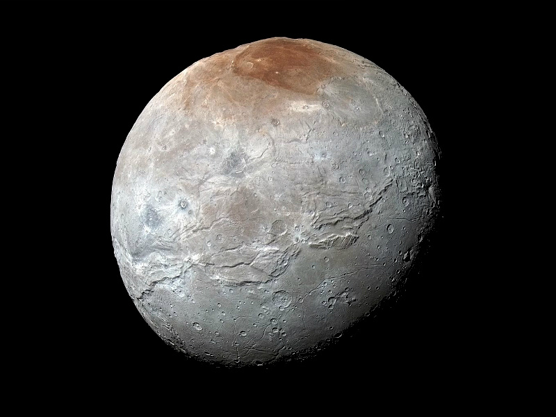 NASA's New Horizons captured this high-resolution enhanced colour view of Pluto's moon Charon, showing the crack on the 753-mile-wide icy moon. It was taken just before closest approach on 14July 2015. The image combines blue, red and infrared images and the colours are processed to best highlight the variation of surface properties across Charon. Image credit: NASA/JHUAPL/SwRI.