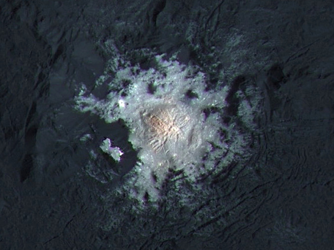 Occator Crater is 57miles (92kilometres) wide, with a central pit around 6miles (10kilometres) wide. This enhanced-colour view highlights subtle colour differences on Ceres' surface. Image credit: NASA/JPL-Caltech/UCLA/MPS/DLR/IDA/PSI/LPI.