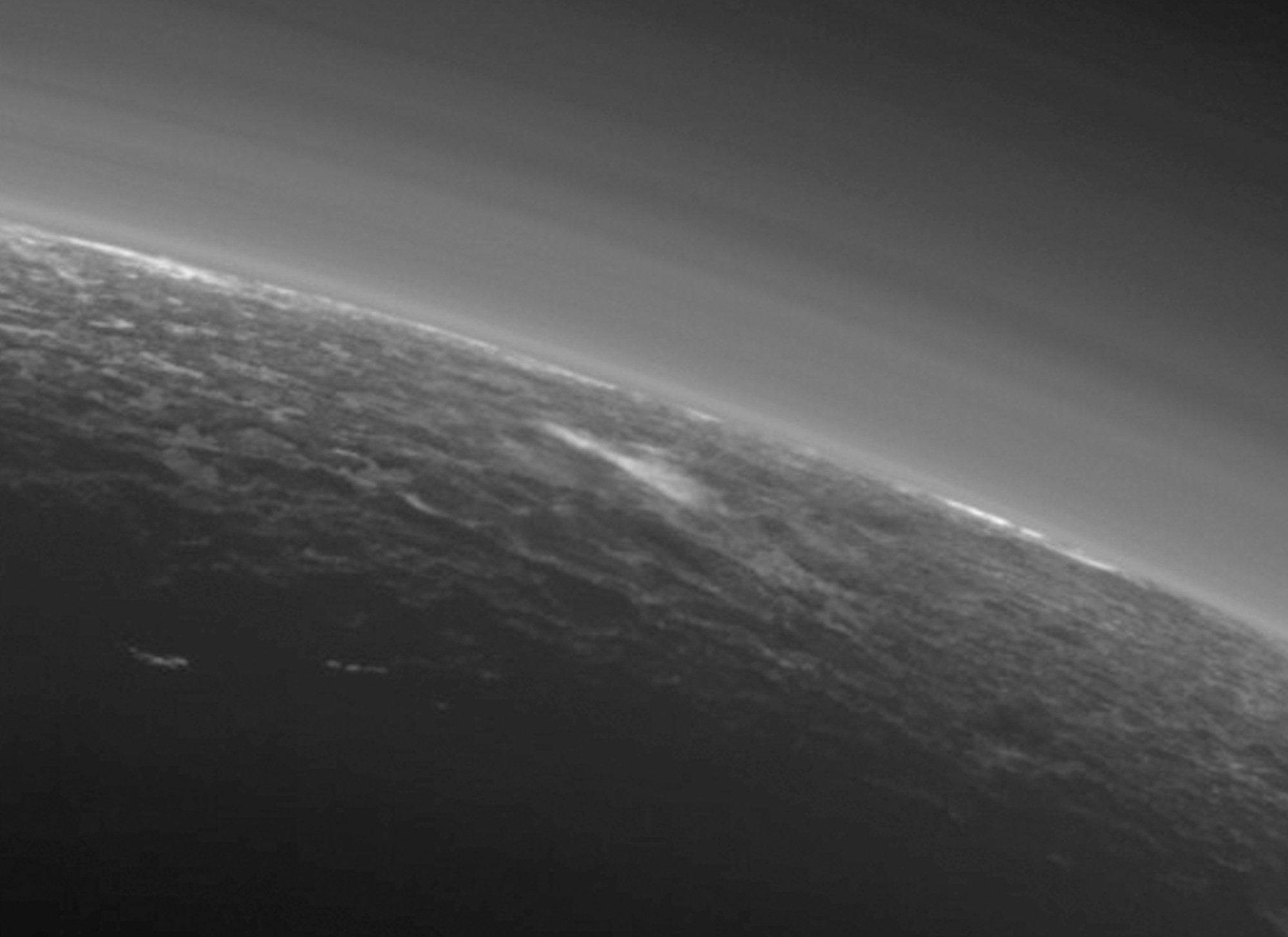 Inset A shows a detail of Pluto's crescent, including an intriguing bright wisp (near the centre) measuring tens of miles across that may be a discreet, low-lying cloud in Pluto's atmosphere; if so, it would be the only one yet identified in New Horizons imagery. This cloud — if that's what it is — is visible for the same reason the haze layers are so bright: illumination from the sunlight grazing Pluto's surface at a low angle. Atmospheric models suggest that methane clouds can occasionally form in Pluto's atmosphere. The scene in this inset is 140 miles (230 kilometres) across. Image credit: NASA/JHUAPL/SwRI.