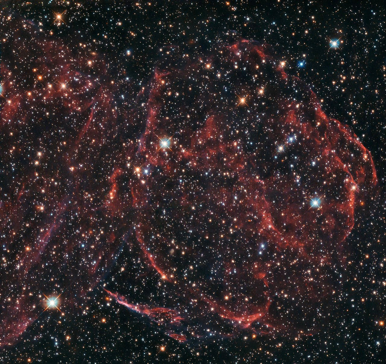 Supernova remnant DEM L316A lies in the Large Magellanic Cloud some 160,000 light-years away in the far southern constellation of Dorado. Image credit: ESA/Hubble & NASA, Y. Chu.