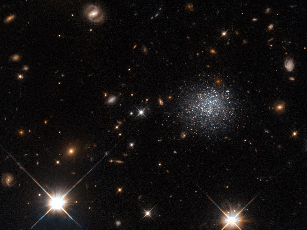 A NASA/ESA Hubble Space Telescope image of LEDA677373 (α=13h37.0m, δ=-33°22' J2000), a dwarf galaxy 14million light-years away in the constellation of Centaurus. Image credit: ESA/Hubble & NASA.