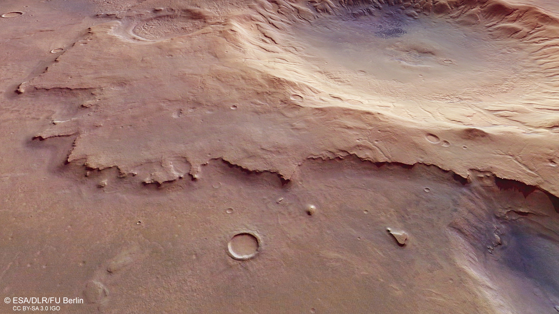 The unnamed Martian impact crater to the upper right of this image from ESA's Mars Express spacecraft is around 50 kilometres (30 miles) in diameter. Click the image for a full-size version. Image credit: ESA/DLR/FU Berlin, CC BY-SA 3.0 IGO.