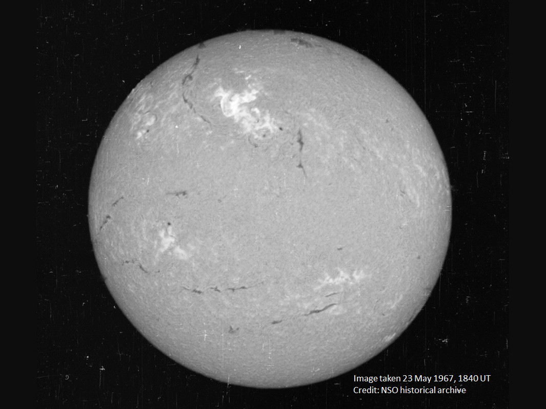 A view of the Sun on 23 May 1967, in a narrow visible wavelength of light called Hydrogen-alpha. The bright region in the top center region of brightness shows the area where the large flare occurred. Image credit: National Solar Observatory historical archive.