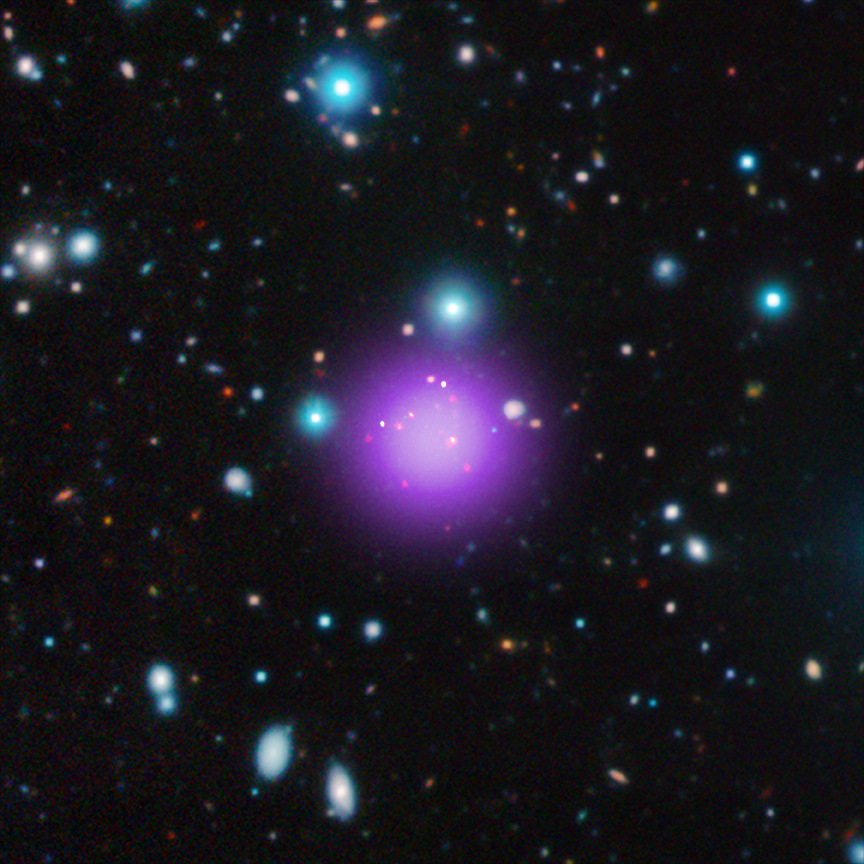 This image contains the most distant galaxy cluster, a discovery made using data from NASA's Chandra X-ray Observatory and several other telescopes. The galaxy cluster, known as CLJ1001+0220, is located about 11.1billion light years from Earth in the constellation of Sextans and may have been caught right after birth — a brief, but important stage of cluster evolution never seen before. This is a composite image where X-rays are purple, infrared is red, green and blue and radio green. Image credit X-ray: NASA/CXC/Université Paris/T.Wang et al; Infrared: ESO/UltraVISTA; Radio: ESO/NAOJ/NRAO/ALMA.