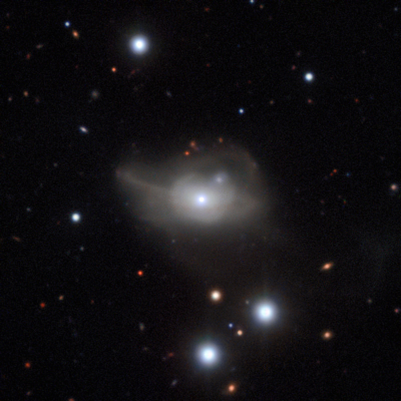 This image from the MUSE instrument on ESO's Very Large Telescope shows the active galaxy Markarian1018, which has a supermassive black hole at its core. The faint loops of light around the galaxy are a result of its interaction and merger with another galaxy in the recent past. Image credit: ESO/CARS survey.