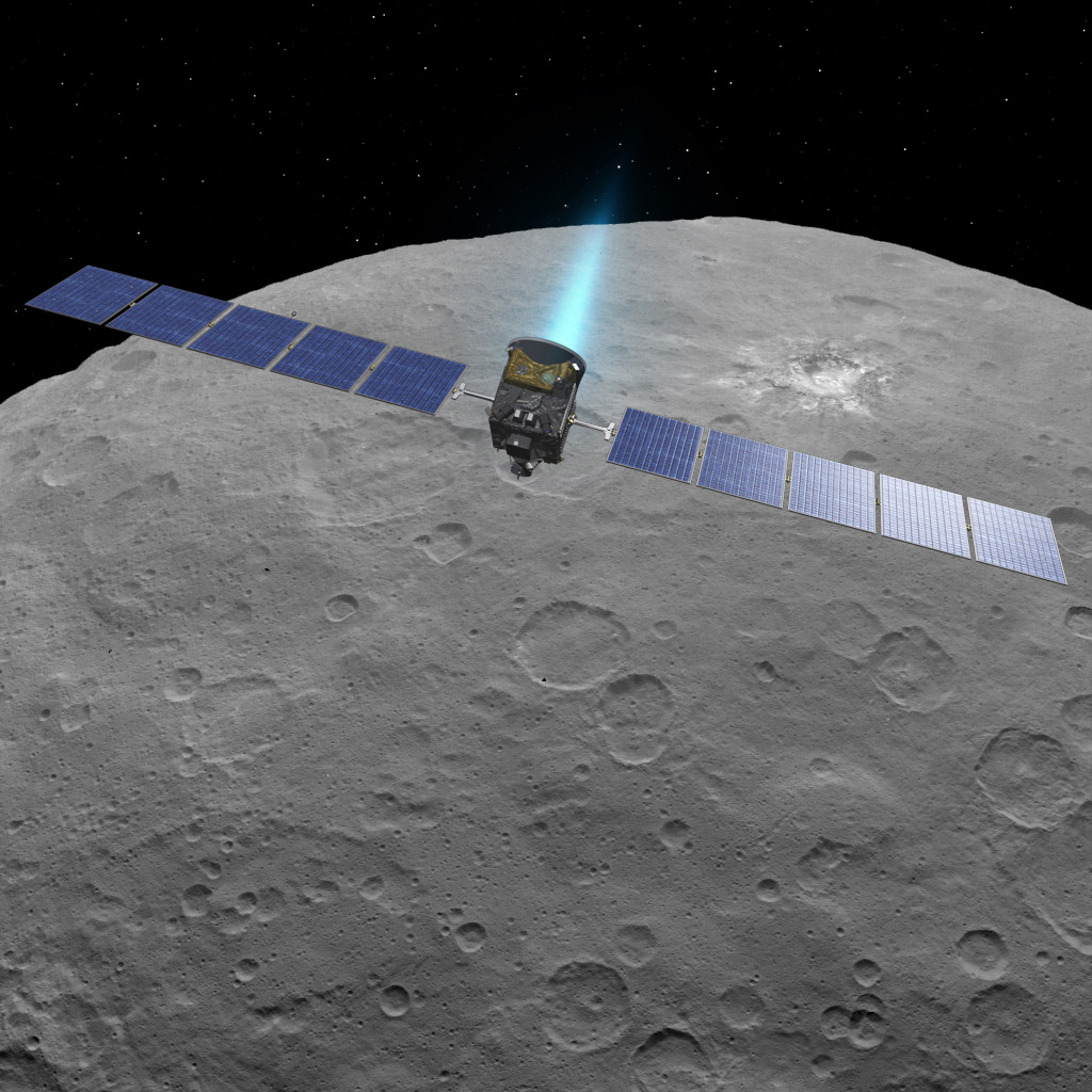 This artist concept shows NASA's Dawn spacecraft above dwarf planet Ceres, as seen in images from the mission. NASA/JPL-Caltech.