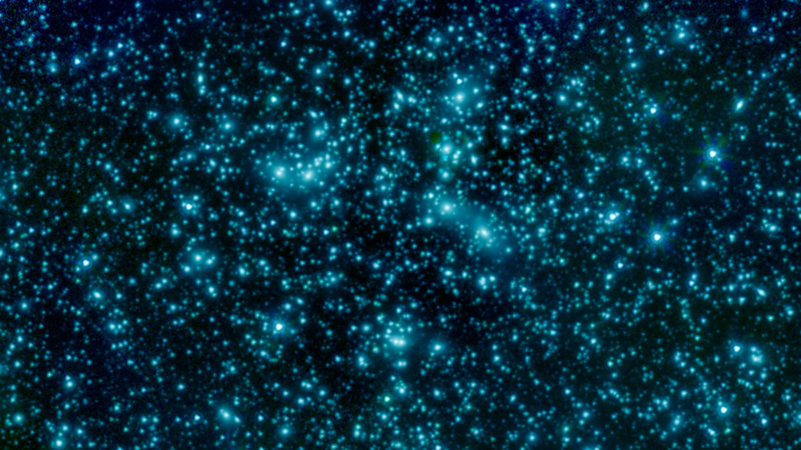This image of galaxy cluster Abell 2744, also called Pandora's Cluster, was taken by NASA's Spitzer Space Telescope. The cluster is also being studied by the NASA/ESA Hubble Space Telescope and Chandra X-Ray Observatory in a collaboration called the Frontier Fields project. Image credit:NASA/JPL-Caltech.