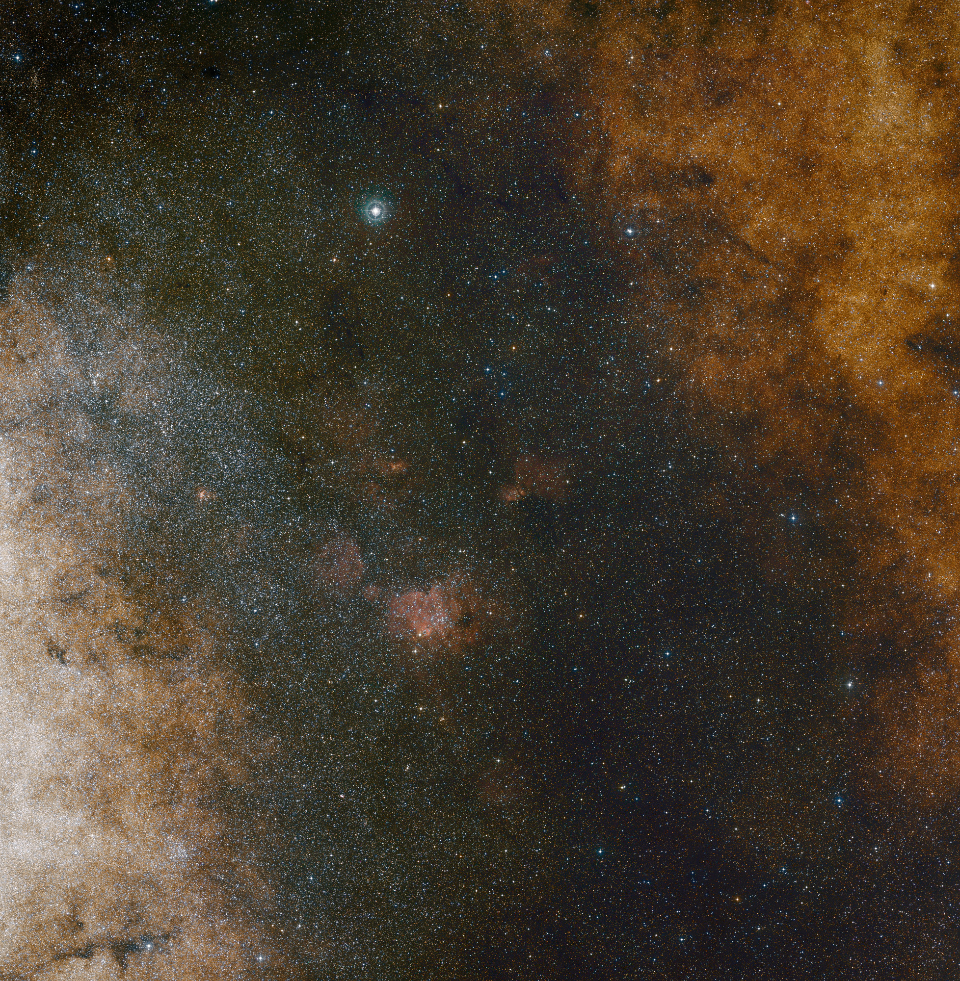 This visible light wide-field view shows the rich star clouds in the constellation of Sagittarius (the Archer) in the direction of the centre of our Milky Way galaxy. The entire image is filled with vast numbers of stars — but far more remain hidden behind clouds of dust and are only revealed in infrared images. This view was created from photographs in red and blue light and forming part of the Digitised Sky Survey 2. The field of view is approximately 3.5 degrees x 3.6 degrees. Image credit: ESO and DSS 2. Acknowledgment: Davide De Martin and S. Guisard.