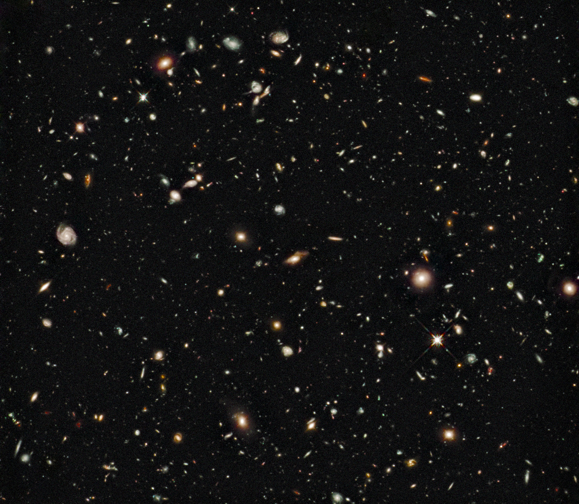 A Hubble image of a field of distant galaxies. A new study of the gas content in galaxies so distant their light has been travelling for about ten billion years suggests that the processes converting gas into stars is about the same back then as in the local universe. Image credit: NASA, ESA, G. Illingworth (UCO/Lick & UCSC), R. Bouwens (UCO/Lick & Leiden U.), and the HUDF09 Team.