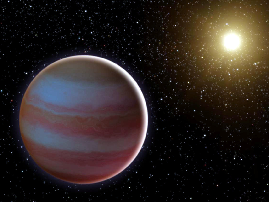 An artist's impression of the newly discovered brown dwarf, an object that weighs in somewhere between 30 and 65 Jupiter masses. The reseachers also found that the brown dwarf orbits a K dwarf, a type of star that tends to have about half the mass of the Sun. Image credit: NASA/JPL-Caltech.