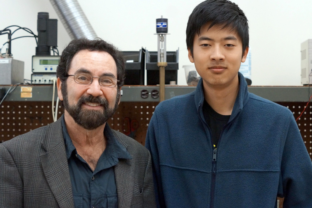 Physics professor Philip Lubin, left, heads UCSB's Experimental Cosmology Group, and is adviser to undergrad astrophysics major Qicheng Zhang, right. Image credit: Sonia Fernandez.