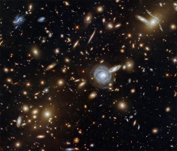 - 051921 galaxies - Galaxy cluster warps space, magnifying more distant galaxies – Astronomy Now